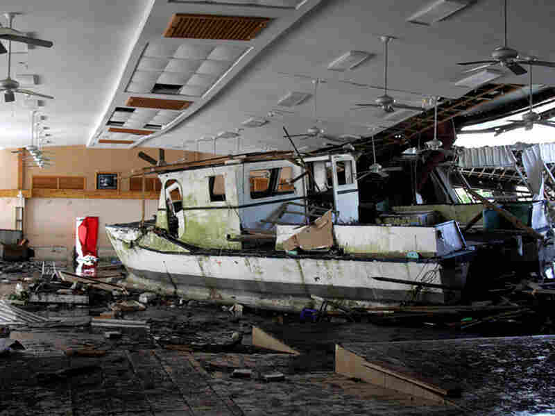 A damaged boat inside a building in Pago Pago village, American Samoa.