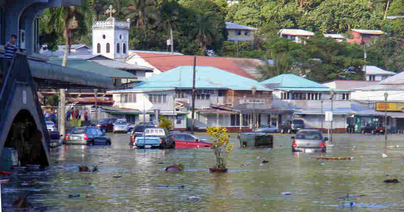 A main road in the downtown area of Fagatogo, American Samoa, is flooded by water on Sept. 29.