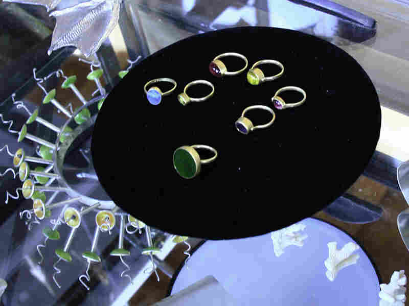 Kiowa jeweler Keri Ataumbi is inspired, in part, by her love for gardening. Here, her jewelry is on display at her booth. Ataumbi says her series of rings with opalescent stones — tourmalines, opals, labradorites and jade — remind her of insects.
