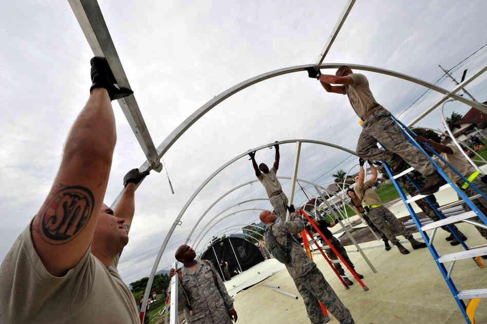 U.S. soldiers erect a makeshift tent for their medical support base to give assistance to quake victims near the M. Jamil hospital Tuesday in Padang. The US Pacific Command flew two C-17 military transport aircraft to Padang with materials for the field hospital.