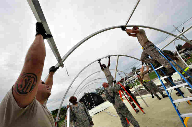 U.S. soldiers erect a makeshift tent for their medical support base to give assistance to quake victims n