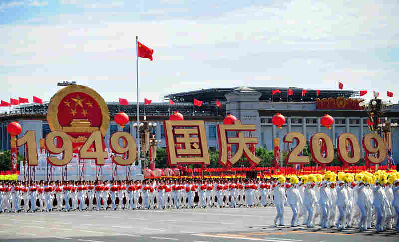 China's state-led celebrations of 60 years of communist rule began Thursday with a 60-gun salute over Beijing's Tiananmen Square. Most of Beijing's 17 million citizens watched the pageant on television.