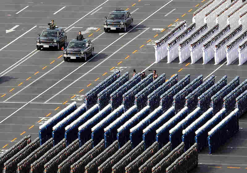 Chinese President Hu Jintao (second car from left) reviews military troops during the parade, which was intended to showcase the nation as a global power.