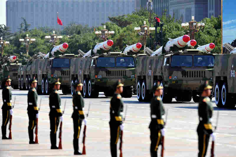 A military parade showcases China's latest missiles during the National Day Parade in Beijing on Thursday.