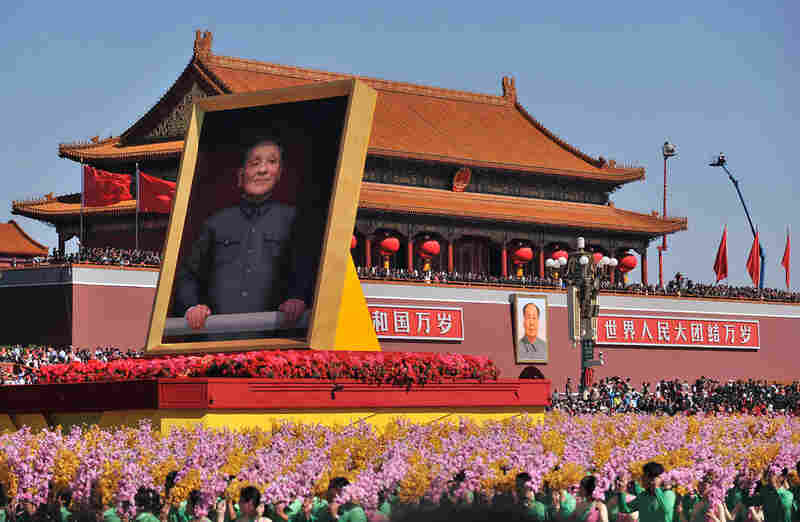 A float with a giant portrait of late Chinese leader Deng Xiaoping passes Tiananmen Square during the parade.