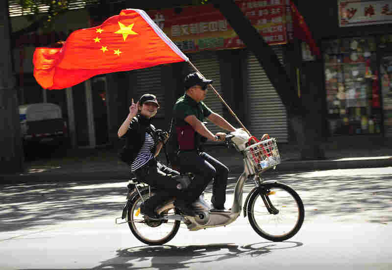 Residents celebrate National Day in Beijing on Thursday.