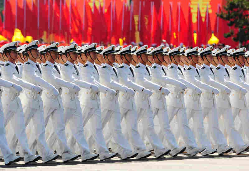 Chinese naval officers march pass Tiananmen Square during the National Day Parade.