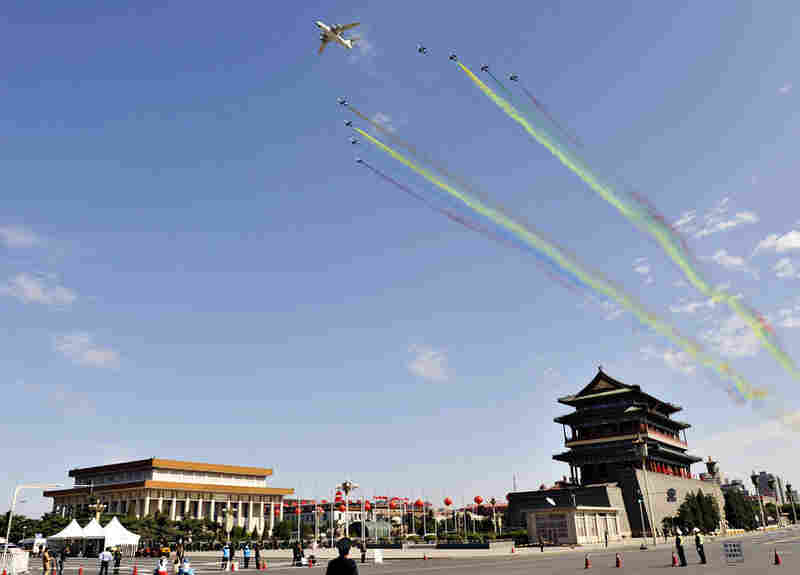 Chinese military aircrafts execute a flyby over Tiananmen Square during the National Day celebrations.