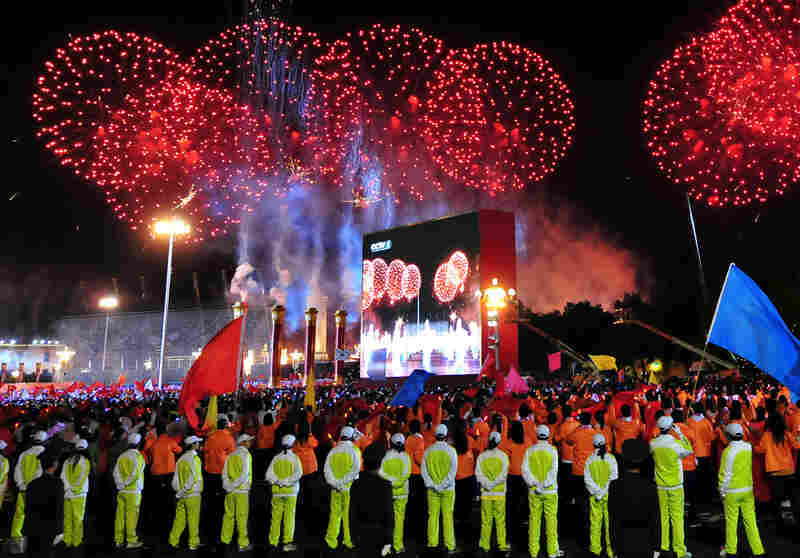 Fireworks light up the sky over Tiananmen Square during the celebrations Thursday.