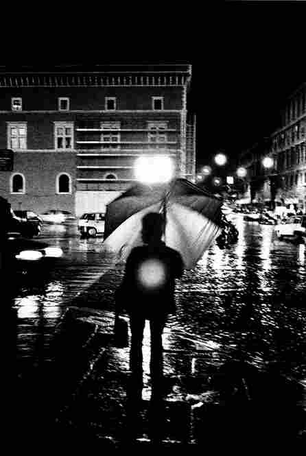 """Woman with umbrella,"" Rome 1999."