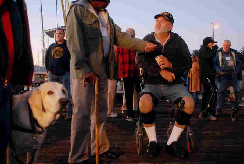 The Monterey Bay Veterans Sports Rehabilitation Center uses fishing to help wounded veterans recover both mentally and physically. Here, participants and volunteers wait to board boats early in the morning.