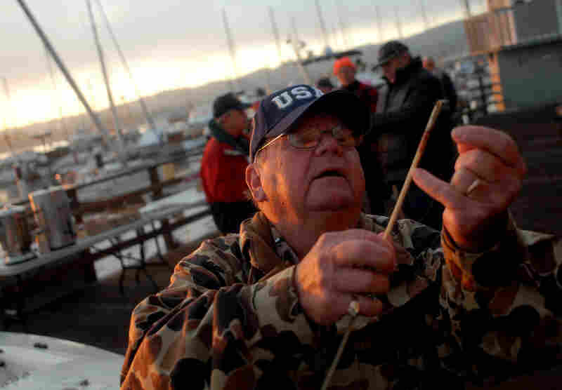 U.S. Air Force veteran Don Grant prepares his fishing gear at Breakwater Cove Marina before the 19th annual Monterey Bay Veterans Wheelchair Rock Cod Derby for veterans with disabilities on Sept. 26, 2009.
