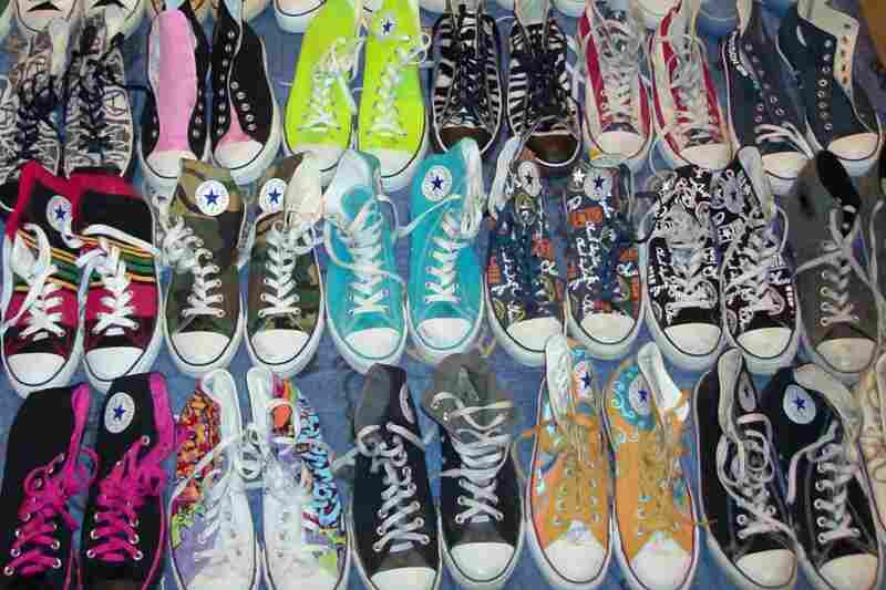 """""""I could not pick just one pair so I took a picture of them all. My favorite shoes are Chuck Taylors. I have a total of 38 pairs. My favorite ones are long gone. They were a pair of zebra-striped high tops. They looked pretty normal until you turned out the lights. I didn't know it when I bought them, but they glowed in the dark."""" — Lynn Cranford, Dallas"""