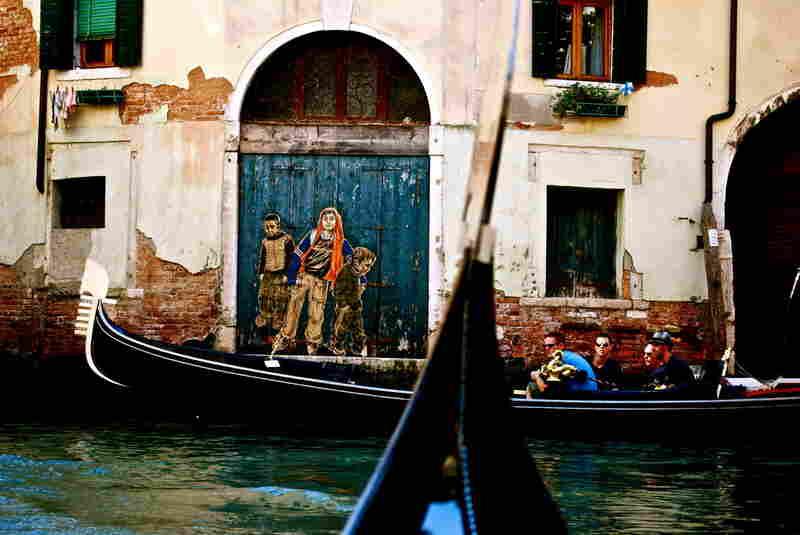 On a gondola ride in Venice