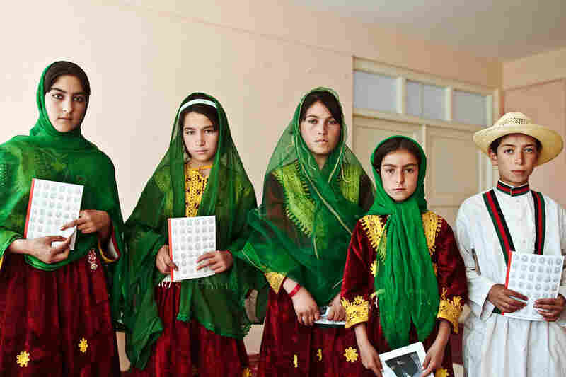 Local children from the city of Chagcharan, Afghanistan, display traditional Tajik clothing prior to the arrival of U.S. Ambassador Karl W. Eikenberry at the governer's home.