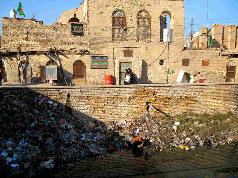 """Um Mohammed, one of the workshop's participants, chronicled the destruction of her beloved home city of Basra. She writes, """"Nothing is left of it but ruin and destruction, broken bricks, collapsing houses.  Everyday, the river shrinks — it's full of garbage."""""""