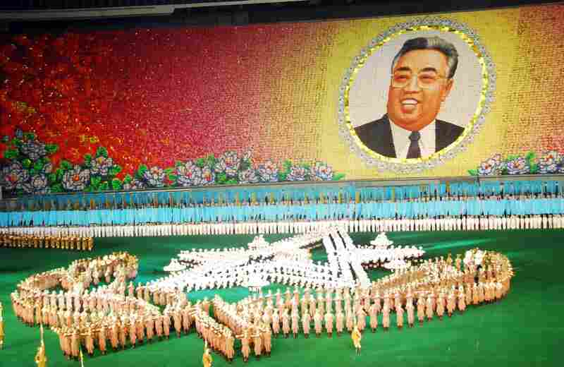 Tens of thousands of North Koreans are taking part in the months-long Arirang Mass Games — a celebration of the birth of Kim Il Sung. Here, dancers perform on a stadium field while schoolchildren in the stands behind them flip cards to create a moving backdrop.