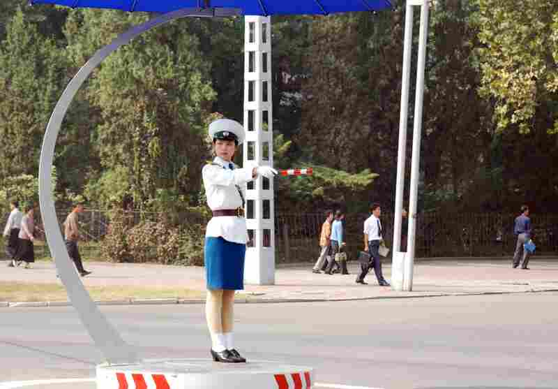 Women, not lights, control traffic in Pyongyang. The female traffic directors stand in demarcated circles in the middle of intersections, and some have umbrellas to shade their faces.
