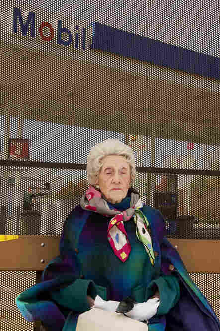 """A 97-year-old woman waits for the bus in her Sunday best in Chamblee, Ga."""