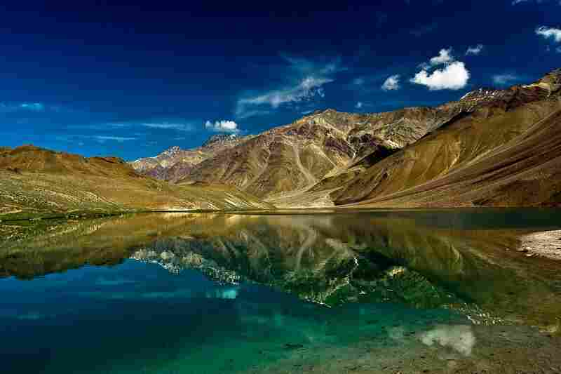 """Chandra Tal (meaning the Lake of the Moon), is situated ... in the Spiti district of Himachal Pradesh (India). The name of the lake originates from its crescent shape."""