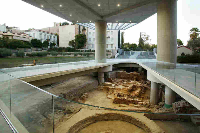 The museum was constructed as part of a campaign by the Greek government to encourage the return of the Parthenon Marbles, also known as the Elgin Marbles. The museum is built atop an archaeological excavation.  The excavation is visible through this open area near the entrance and various glass floors.