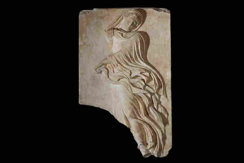 A relief plaque depicting a female dancer from the Theatre of Dionysus, circa 1st century B.C.