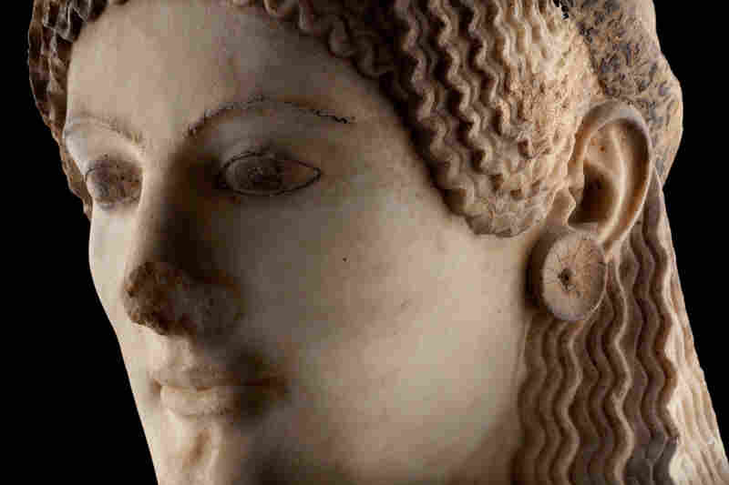 A detail of the marble sculpture known as Peplos Kore, circa 530 B.C., a statue of a young Greek woman now on display in the museum.