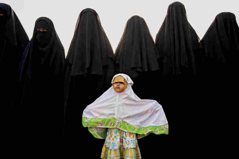 The women of the An-Nadzir commune begin Islam's Feast of the Sacrifice, celebrating the Koran's account of God sparing the prophet Ismail.