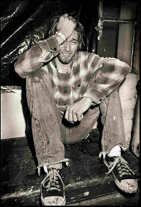 """Kurt Cobain, Motor Sports International Garage, Seattle, Sept. 22, 1990. """"The band did an awesome set where Kurt continuously smashed his guitar through his amp and speakers. ... Backstage he sat down and burst into tears, with an outpouring of pent-up emotion that just had to go somewhere. ... I had my camera but I was very unsure about taking his photo while he was so vulnerable. I did one..."""