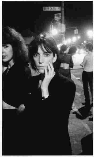 """Patti Smith outside CBGB, Bowery and Bleecker Street, New York City, 1976. """"In between sets at CBGB, everyone stood out on the Bowery to get fresh air. It was so picturesque, and it was there that I took many of my photographs. It was like my own photo studio."""""""