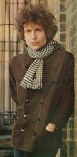 """Bob Dylan, Blonde on Blonde, New York City, 1966. """"We started photographing in the studio and got some very nice photographs but nothing that I thought would be a cover. ... I have always liked the Meatpacking District so we went there. It was cold and neither one of us was dressed warm enough, and because the photograph is blurred and has movement, people were trying to analyze it as some s..."""