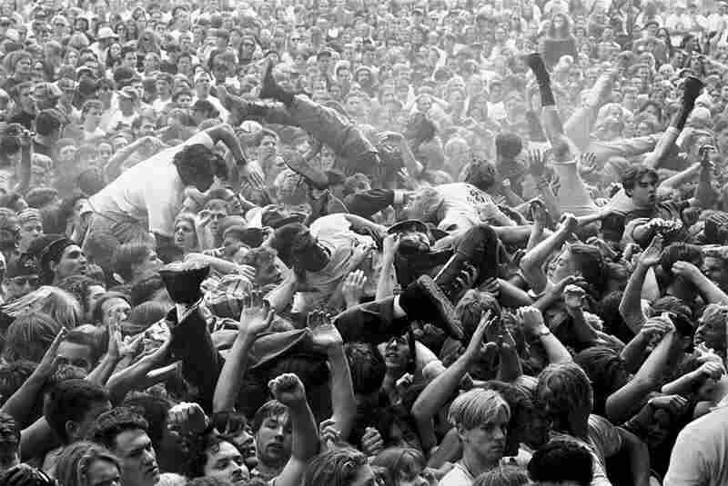 """Mosh pit at a Mudhoney concert at Endfest, Kitsap County, Washington, 1991. """"I've probably changed more than the rock scene has! I don't make it out much anymore being 45 and with a new baby. I do think that the photography has changed, and not for the better. Less access, more controlled by labels and publicists, too much emphasis on the staged portrait. I find it all pretty boring."""" (C..."""