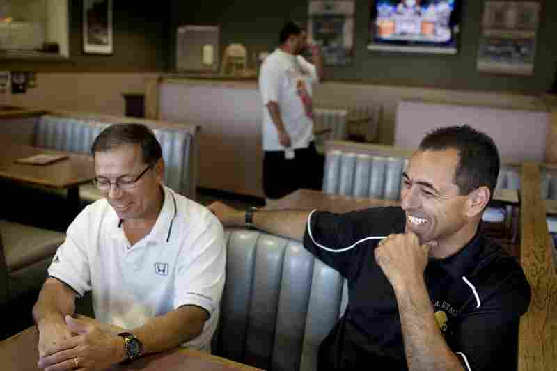 Visger shares high school football stories with his friend and former Stagg High teammate Alex Zanini.