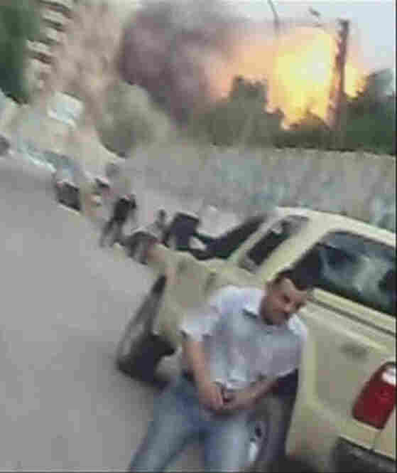 Video images captured on a cell phone show the second blast from two huge car bombs.