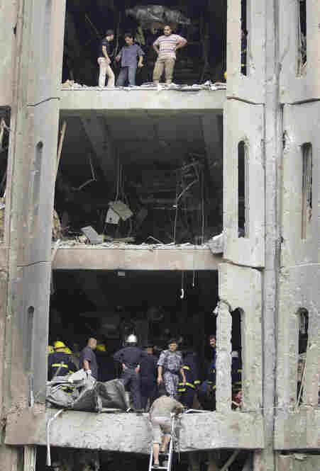 Iraqis inspect the badly damaged building of the Ministry of Justice.
