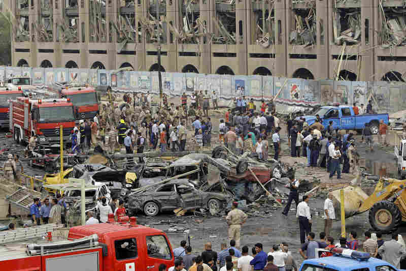 The blasts went off in front of the headquarters of the Baghdad provincial administration and near the Ministry of Justice building during the morning rush hour as people headed to work.