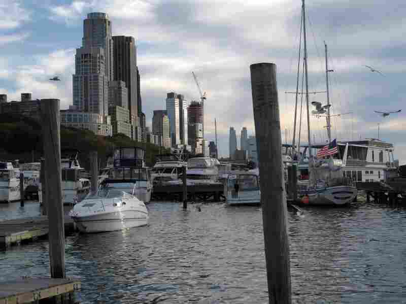 The 79th Street boat basin, along the Hudson River in Manhattan, is used by both small sailboats and large houseboats where people live year-round.