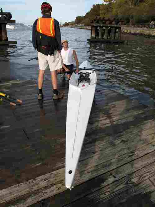 Today a visitor from Oregon, Ray Thomas, who likes to row himself, stops to ask Cumella about his scull.