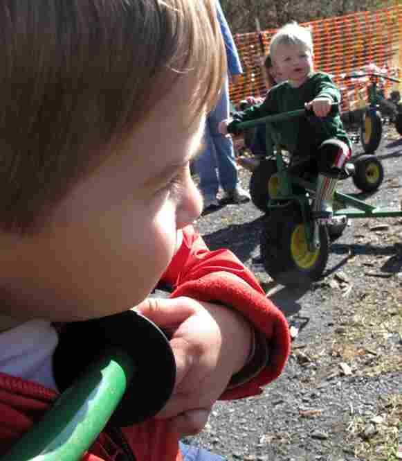 The John Deere tractors came in toddler sizes, and kids raced them around the gravel track.