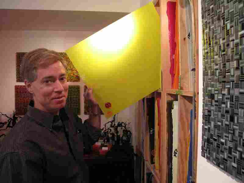 Artist Robert Weiner holds a sheet of glass that he uses to make his Colorbar Murrine Series -  a warm glass technique that allows the glass to fuse together.
