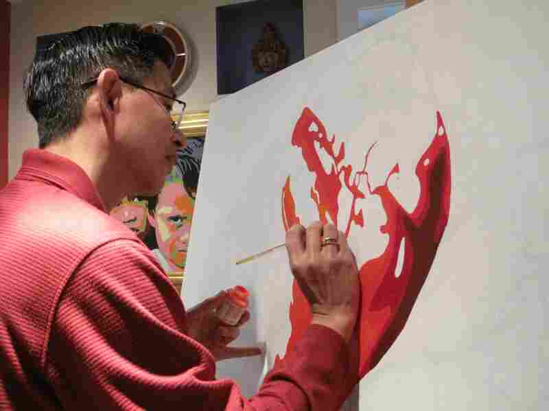 Nicolas Shi painting in his studio on 14th and P street. His work incorporates his Salvadorian upbringing, his Chinese heritage and his education in the United States.