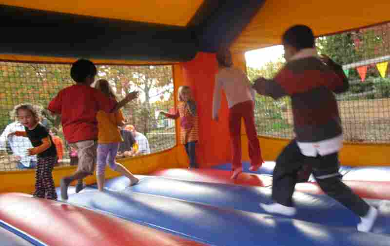 Kids try to launch themselves into orbit in the moon bounce, the most popular attraction at this year's festival.