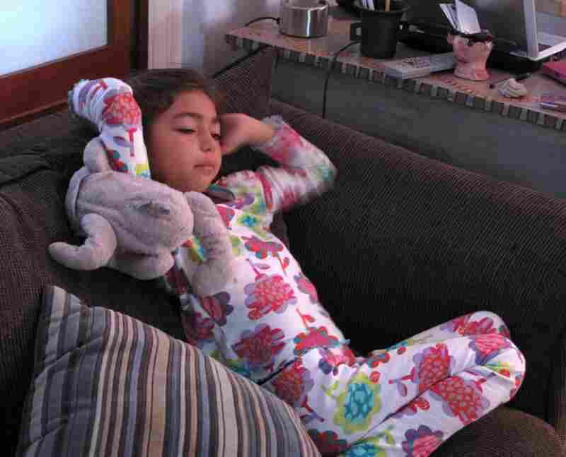 8-year old Sofie Shore wakes up to Mickey Mouse.