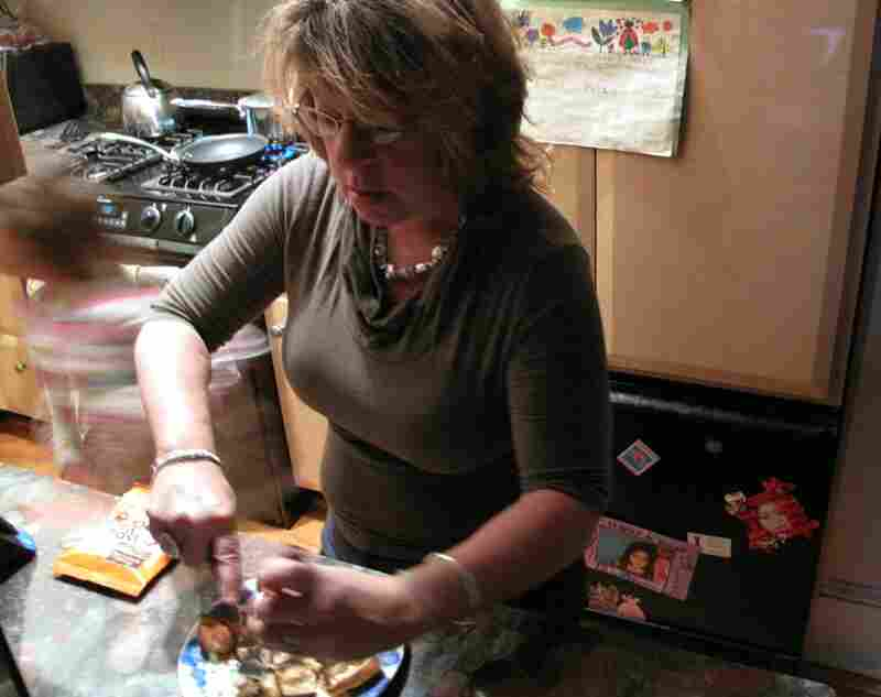 A quick dash into the kitchen, where her mother, Debbie, is making pancakes.