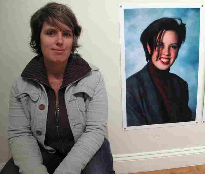 Kate Macdonnell poses next to her high school photo, in which she's wearing a blazer she says she wore every day her freshman year.  Lease enlarged 43 high school photos for another part of the project.