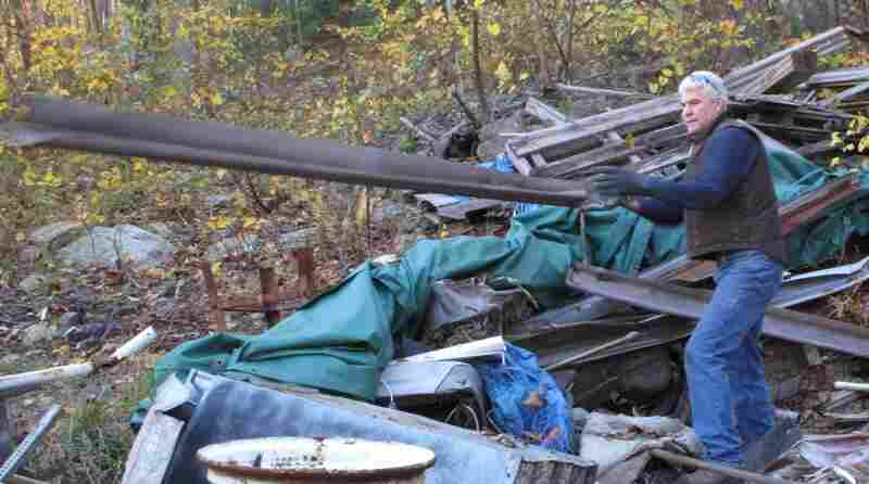 Sam separates the metal from the rest of the junk.