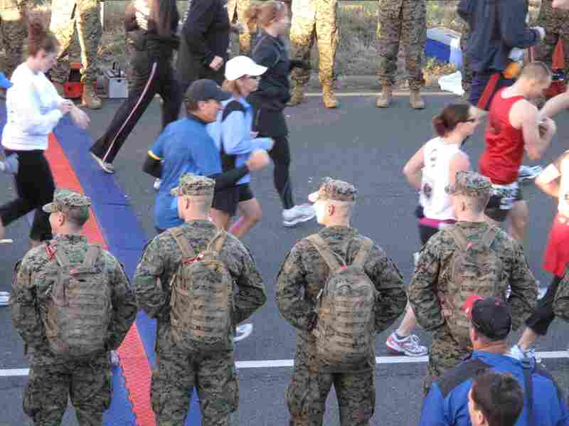 Marines lined the road, as runners took off on the 26.2-mile route.