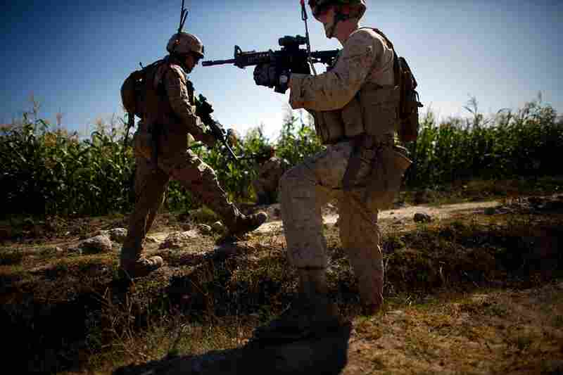 Improvised explosive devices, known as IEDs, are a constant threat to the Marines working in the Helmand River valley. Here, Lt. James Wende (right) keeps a watchful eye on his Marines while on patrol. Since July, bombs in Helmand province have killed 40 Marines and wounded more than 160.
