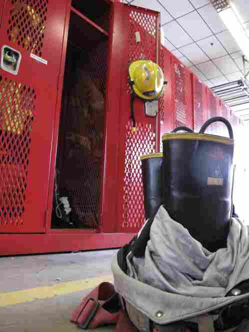 Back at the station, gear is left in position for the next call.  Boots stick out of pants, hoods lay on top of boots, and jackets often hang from truck doors or seats.