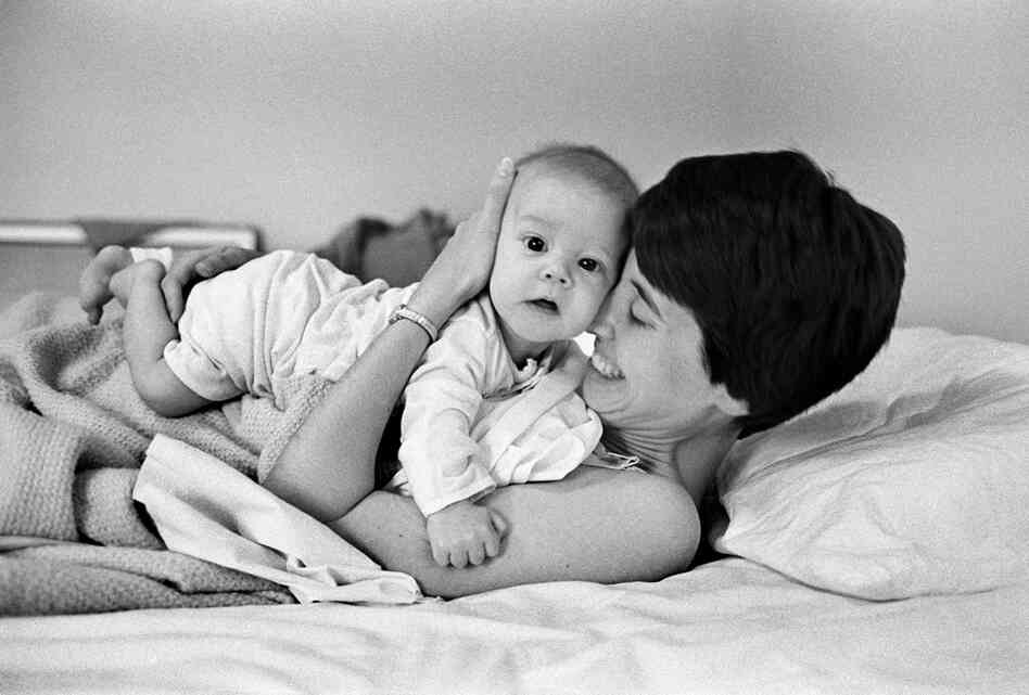 Every morning after Judy nurses David, they cuddle together. She knows such moments will not last. June 1977.
